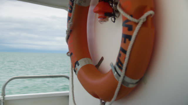 Shot of a lifebuoy hanging on a ship's wall