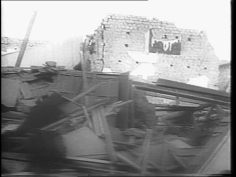 vidéos et rushes de shot of a map that highlights the area of destruction from an earthquake in san juan argentina / shots of rubble lining the streets of the city /... - 1944