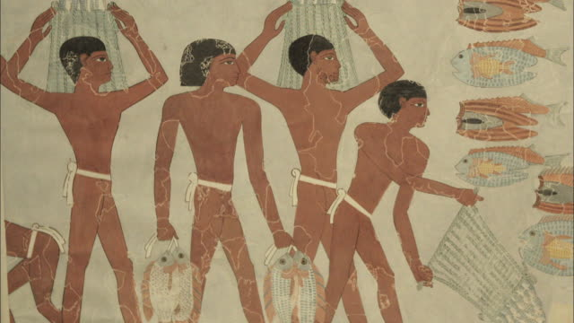 vidéos et rushes de shot of a mural depicting fishermen from ancient egypt - civilisation ancienne