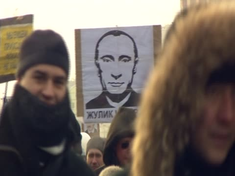stockvideo's en b-roll-footage met shot of a poster of russia prime minister vladimir putin during a anti-putin protest in moscow - moscow russia