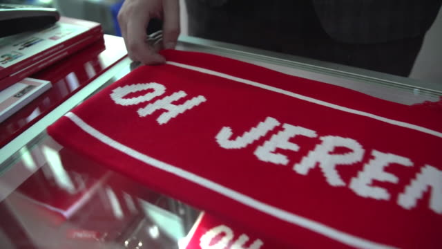 shot of a red 'oh jeremy corbyn' scarf being unfurled on a table at the labour party conference in liverpool - wool gathering stock videos & royalty-free footage