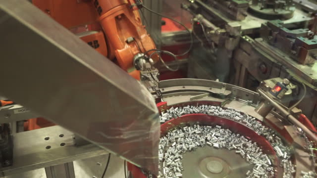 shot of a robot picking up metal bolts on an automated factory production line - bolt stock videos & royalty-free footage