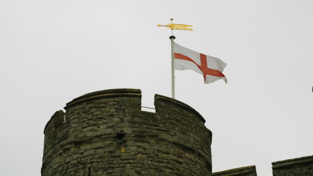 Shot of a Saint George's flag flying from a turret on Canterbury's Westgate.