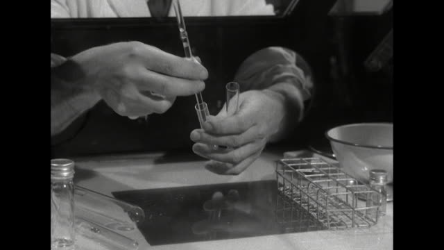 Shot of a scientist moving samples of chickenpox virus between test tubes in a laboratory