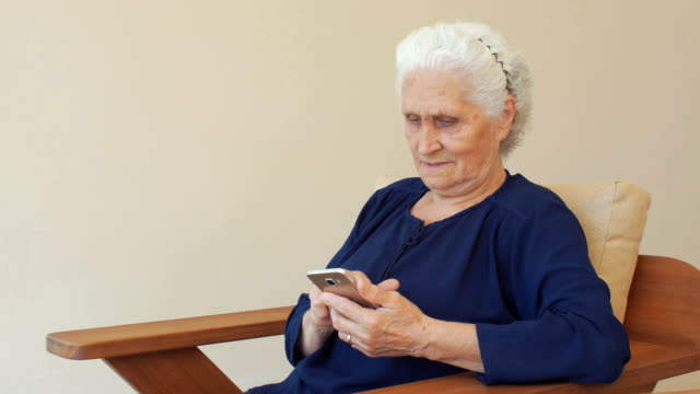 shot of a senior woman using a mobile phone - retirement community stock videos & royalty-free footage