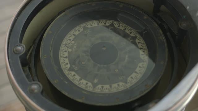 shot of a ship's compass. - kompass stock-videos und b-roll-filmmaterial