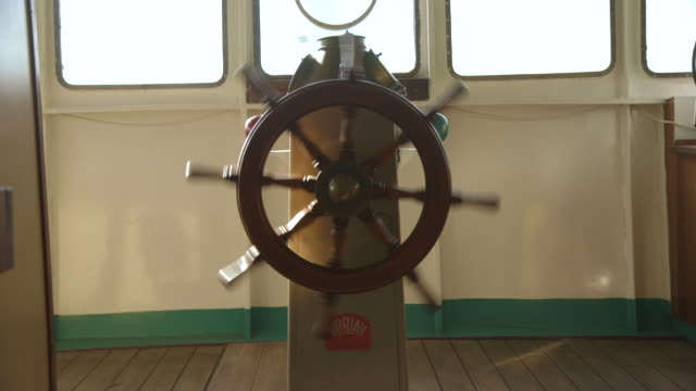 shot of a ships wheel spinning. - helm stock videos & royalty-free footage