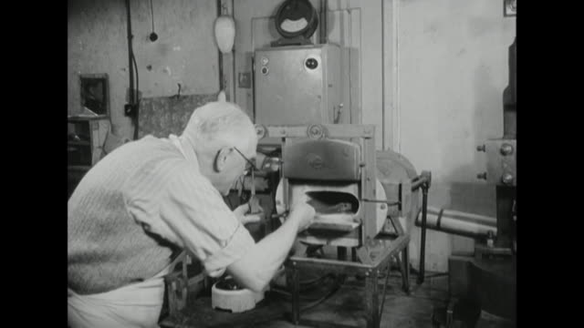 shot of a silversmith using tongs to remove a piece of metal from a small oven - industrie ofen stock-videos und b-roll-filmmaterial