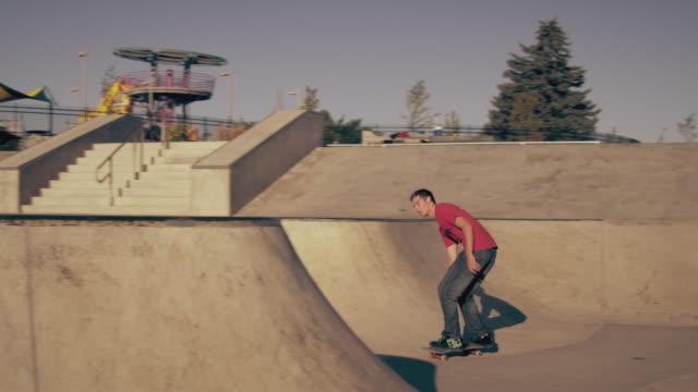 Shot of a skateboarder attempting a backflip on a skateboard.