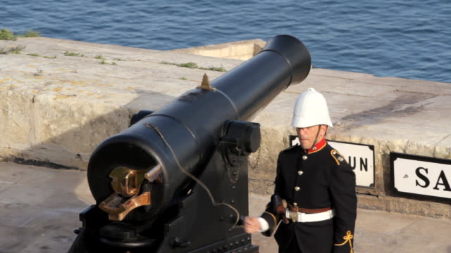 shot of a solider firing a ceremonial cannon from valetta's grand harbour. - fortress stock videos & royalty-free footage