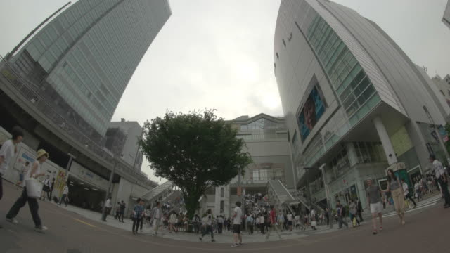 ws, t/l , shot of a square front of the southeast exit of shinjuku station. - wide angle stock videos & royalty-free footage