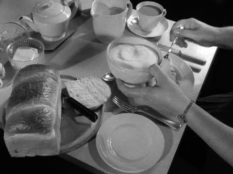 shot of a table laid out for breakfast. a person sprinkles sugar and pours milk onto their porridge. - pouring stock videos & royalty-free footage