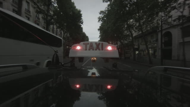pov shot of a taxi driving down the rue de la paix in traffic in paris, france - taxi stock videos & royalty-free footage