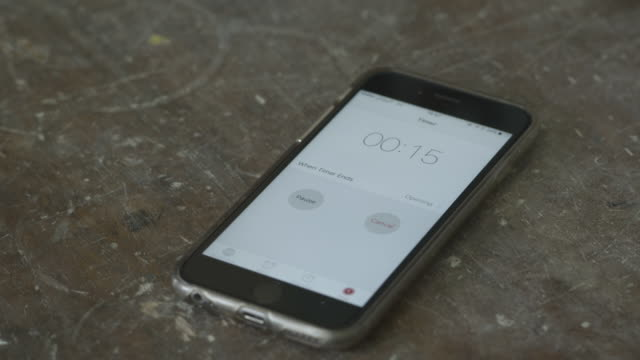 shot of a timer counting down on a smartphone. - timer stock videos & royalty-free footage