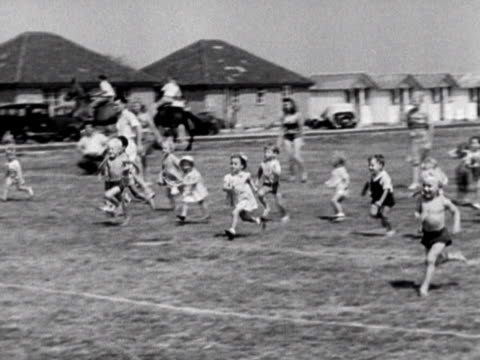 shot of a toddlers race at the coronation holiday camp on hayling island. 1948. - holiday camp stock videos & royalty-free footage