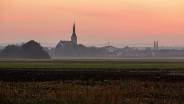 t/l 8k shot of a town in morning fog - small town stock videos & royalty-free footage