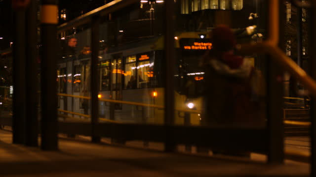 Shot of a tram departing St Peters Square tram stop in Central Manchester
