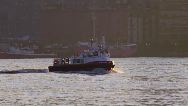 shot of a tugboat quickly moving along the hudson river - tugboat stock videos and b-roll footage