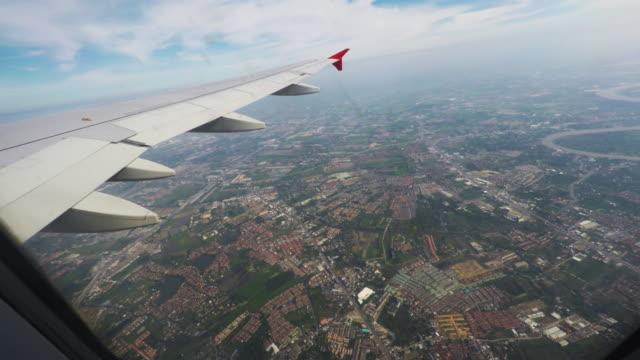shot of a view through a window of an aircraft.