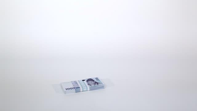 Shot of a wad of thousand won(Korean money unit)