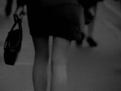 a shot of a woman wearing a mini skirt walking away from the camera 1967 - purse stock videos & royalty-free footage