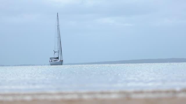 Shot of a yacht anchored near the shore