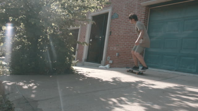 A shot of a young man skateboarding through the streets of Brooklyn, NYC