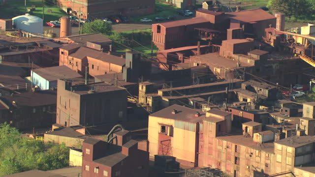 stockvideo's en b-roll-footage met ms aerial ds shot of abandoned buildings that might be steel recycling plant at one time / easton, pennsylvania, united states - verwerkingsfabriek