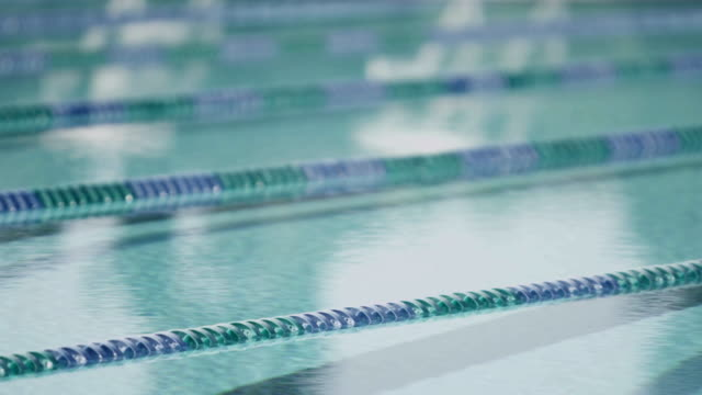 MS SLO MO Shot of Abstract shot, surface of empty pool and lane lines / Davis, California, United States