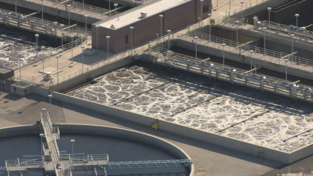 ms aerial shot of activated sludge ponds at water pollution control facility in daylight / las vegas, nevada, united states - sewage stock videos and b-roll footage