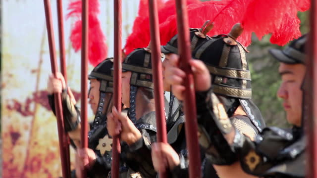ms shot of actors dressing in ancient chinese soldiers / xian, shaanxi, china - ancient stock videos & royalty-free footage