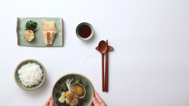 MS Shot of adding miyeokguk (Seaweed Soup) set on table / Seoul, South Korea