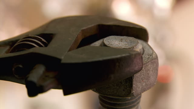 MS Shot of adjustable wrench loosens nut / Estepona,Espana, Malaga, Spain