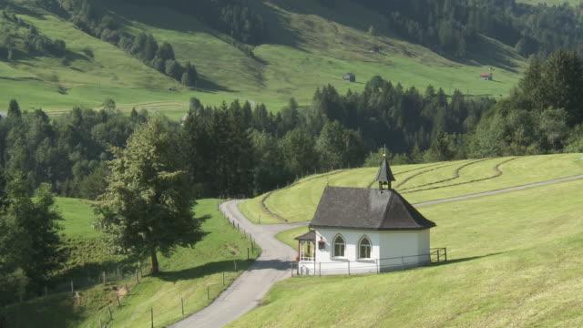 ms shot of ahorn chapel / lehmen, appenzell innerhoden, switzerland    - chapel stock videos & royalty-free footage