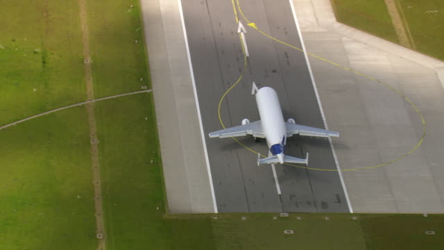 ms aerial zo shot of airbus beluga on airport with car parking area / germany - airbus stock-videos und b-roll-filmmaterial