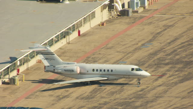 ms aerial zo shot of aircraft on tarmac at hawker beechcraft / wichita, kansas, united states - airfield stock videos & royalty-free footage