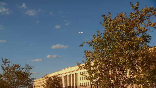MS PAN ZO Shot of airplane flying over pentagon building and September 11th memorial / Arlington, Virginia, United States