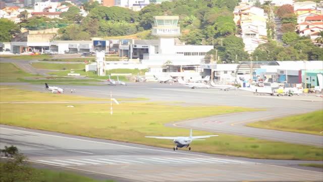 ws ts shot of airplane landing / belo horizonte, minas gerais, brazil - two animals stock videos & royalty-free footage