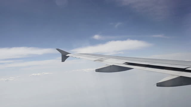 ms arial shot of airplane wing ( aileron is moving ) / bangkok, thailand   - aircraft wing stock videos & royalty-free footage