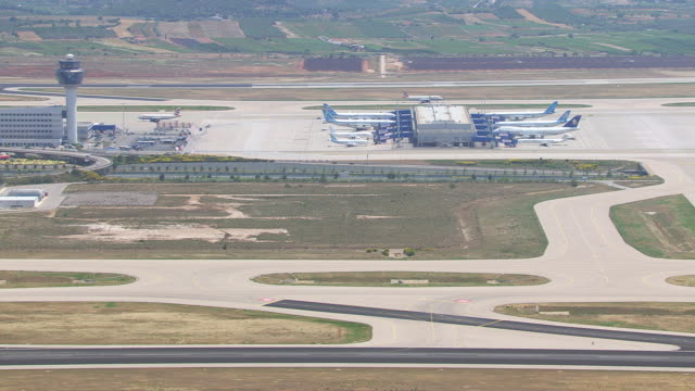 ms aerial zi shot of airport of athens / athens, attica, greece - greece stock videos & royalty-free footage