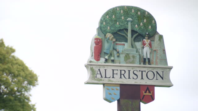 ms shot of alfriston town sign / alfriston east, sussex, united kingdom - east sussex stock videos & royalty-free footage