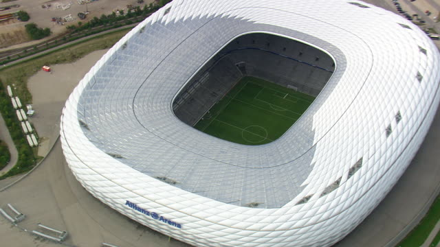 MS AERIAL DS Shot of Allianz arena stadium and road way with vehicle / Germany