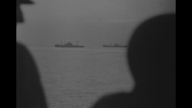 shot of allied naval convoy off coast of sicily, pan across ships in convoy / us vice admiral henry kent hewitt on left and us lt. general mark clark... - sicily stock videos & royalty-free footage