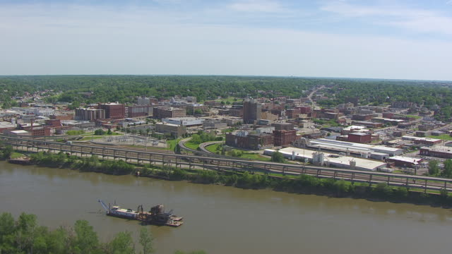 WS AERIAL Shot of along Missouri River with view of town / St Joseph, Missouri, United States