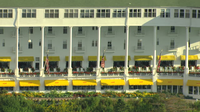 ms aerial shot of  along porch with awning and chairs at victorian grand hotel / mackinac island, michigan, united states - awning stock videos & royalty-free footage