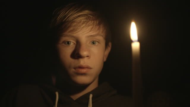cu shot of american boy in candle light / westlake village, california, united states  - westlake village california stock videos & royalty-free footage