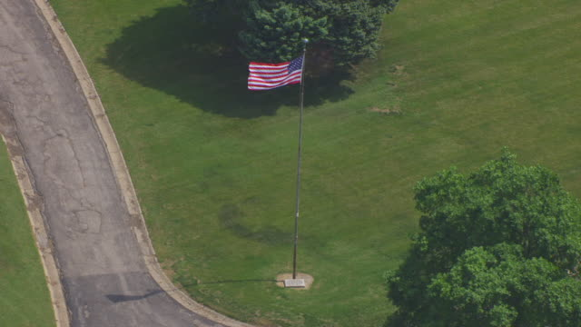 MS AERIAL DS Shot of American flag at Forest Hill Cemetery  / Kansas City, Missouri, United States