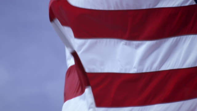 shot of american flag close up and blowing in the wind. - プロボ点の映像素材/bロール