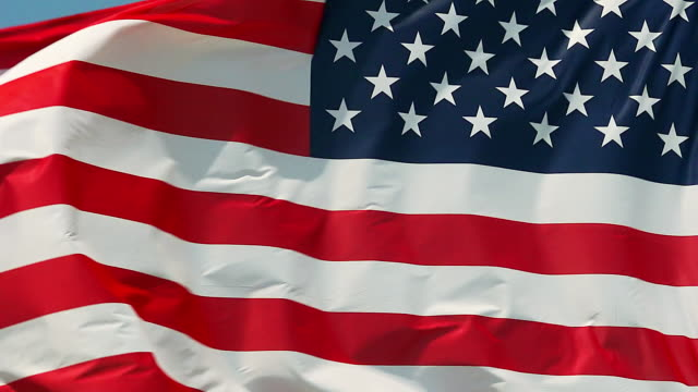 stockvideo's en b-roll-footage met cu slo mo shot of american flag waving in wind / caen, normandy, france - amerikaanse vlag