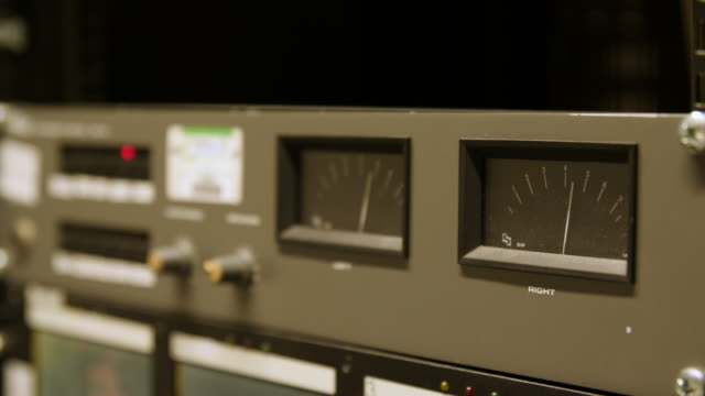 stockvideo's en b-roll-footage met shot of an analogue volume unit meter peaking during audio playback - bbc archives
